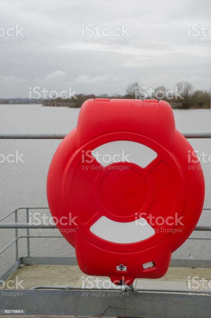 Bright red lifebelt container with reservoir stock photo