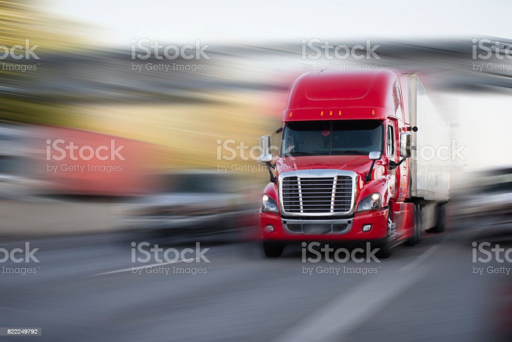 bright red modern big rig semi truck with semi trailer