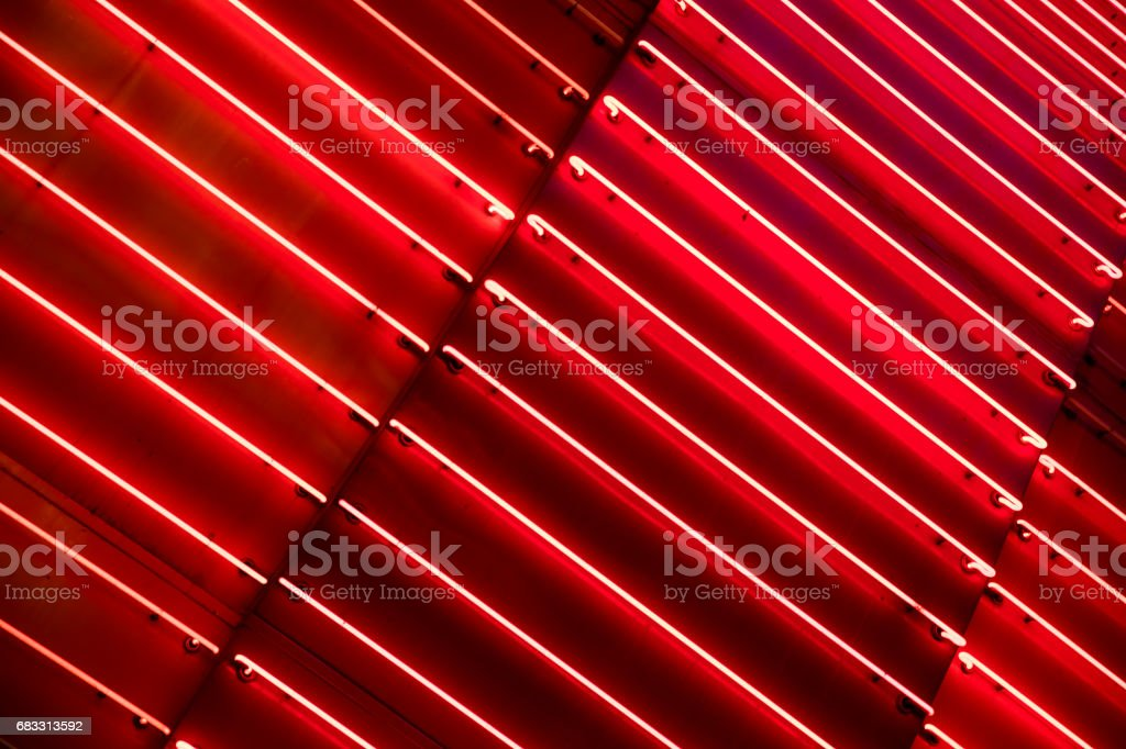 Bright red neon light metallic background. stock photo