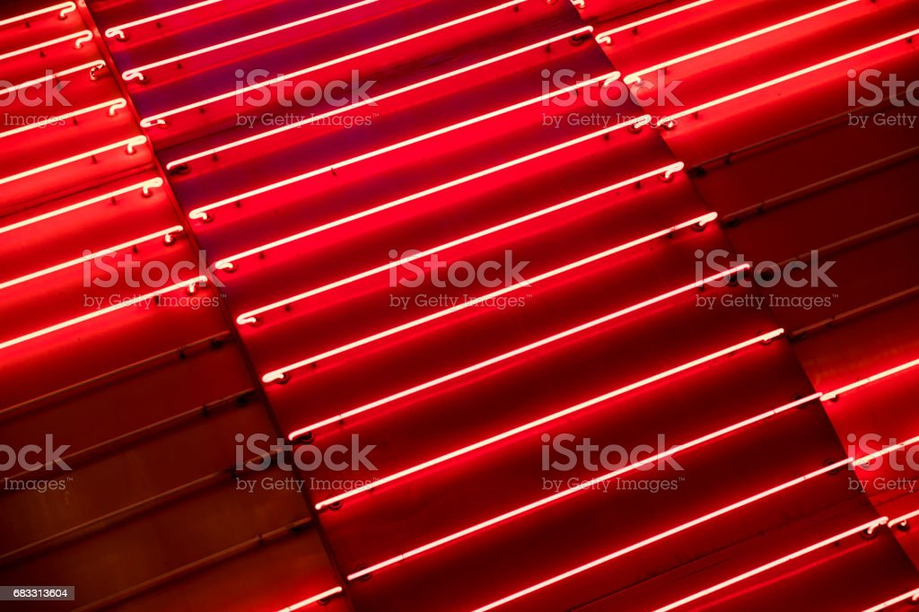 Bright red neon light metallic background. foto stock royalty-free