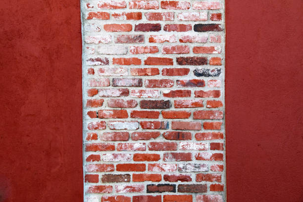 bright red painted vintage brick garden wall column stock photo