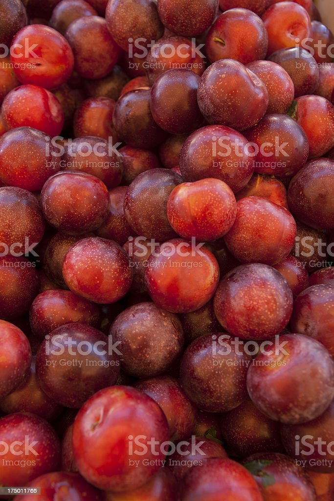 Bright Red Plums stock photo
