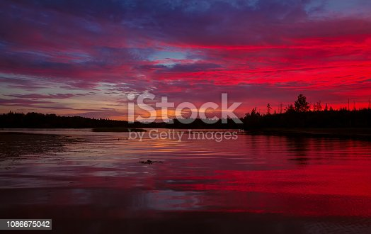 istock Bright red sunset over the lake in Karelia 1086675042