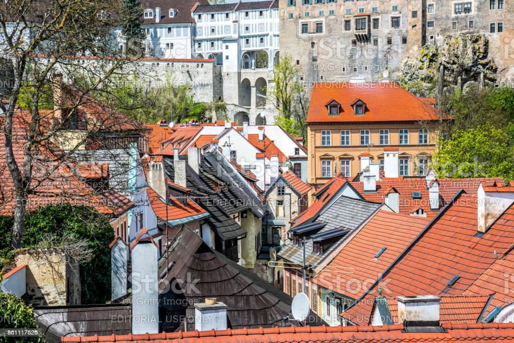 Bright red tile roofs in the old town of Cesky Krumlov in the Czech Republic stock photo