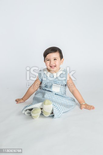 489225417 istock photo bright room. happy boy playing on the floor. A boy in a white t-shirt 1130926768