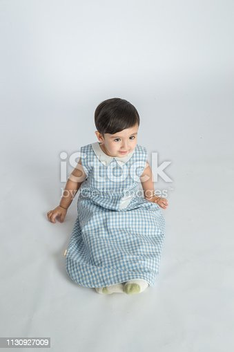 489225417 istock photo bright room. happy boy playing on the floor. A boy in a white t-shirt 1130927009