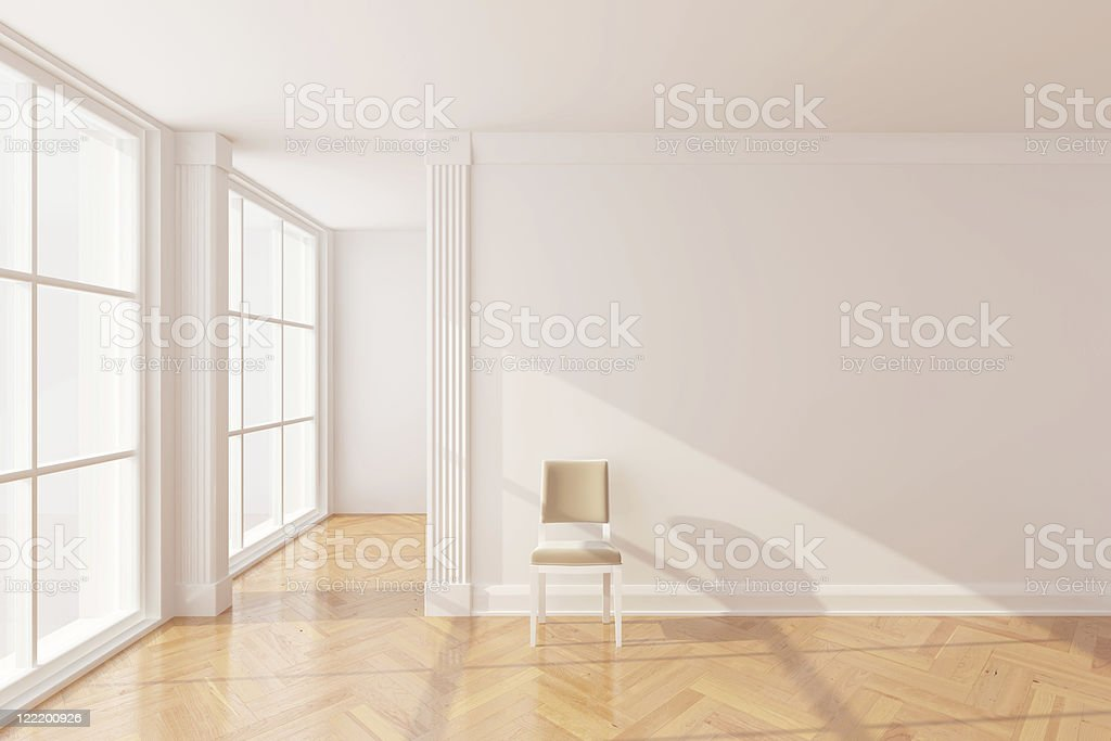 Bright room with large windows, white walls, and wood floors royalty-free stock photo