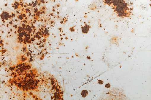 Bright rust stains texture paint showing through to rust underneath