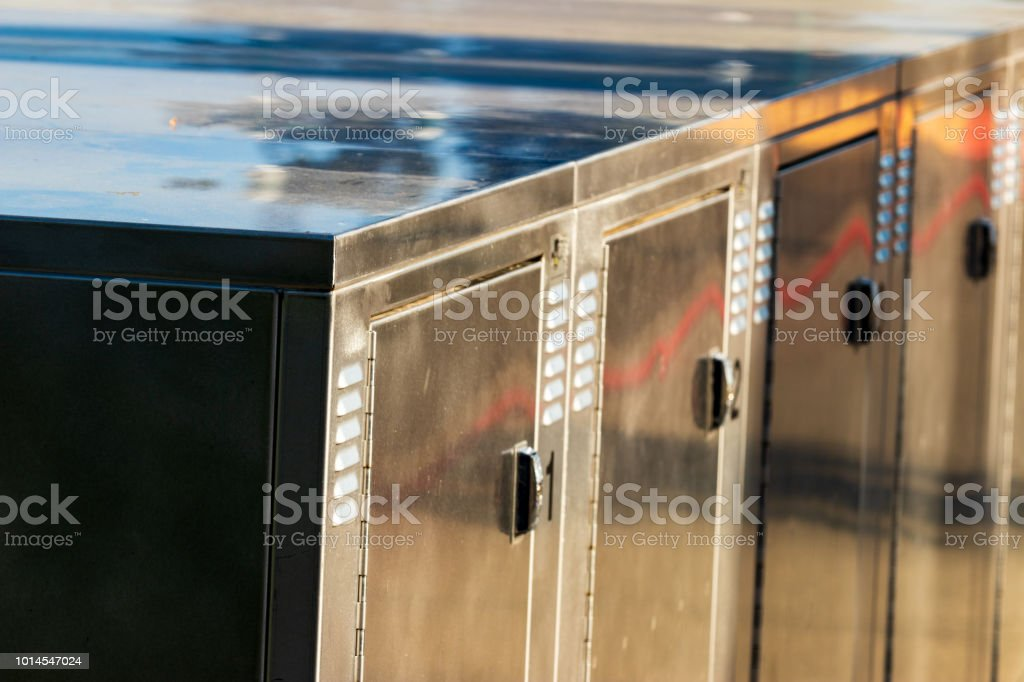 Bright shiny aluminum bicycle lockers close up stock photo