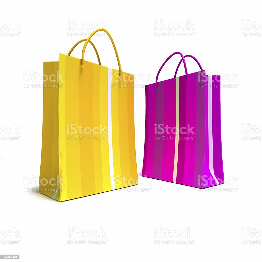 Bright shopping bags in pink and yellow royalty-free stock photo