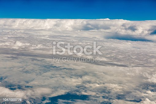 istock Bright sky blue background aerial view frome above. 1047000776