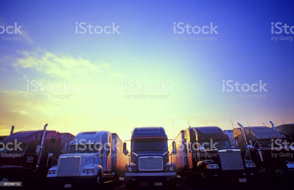 Bright sky Semi-trucks stock photo