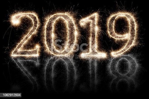 1070880528 istock photo bright sparkler pyrotechnic fireworks number 2019 2018 change happy new year 1062912504