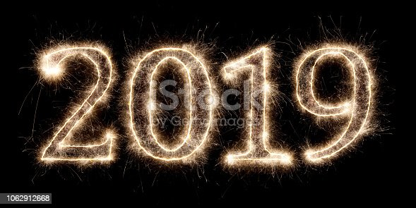 1070880528 istock photo bright sparkler pyrotechnic fireworks number 2019 happy new year 1062912668