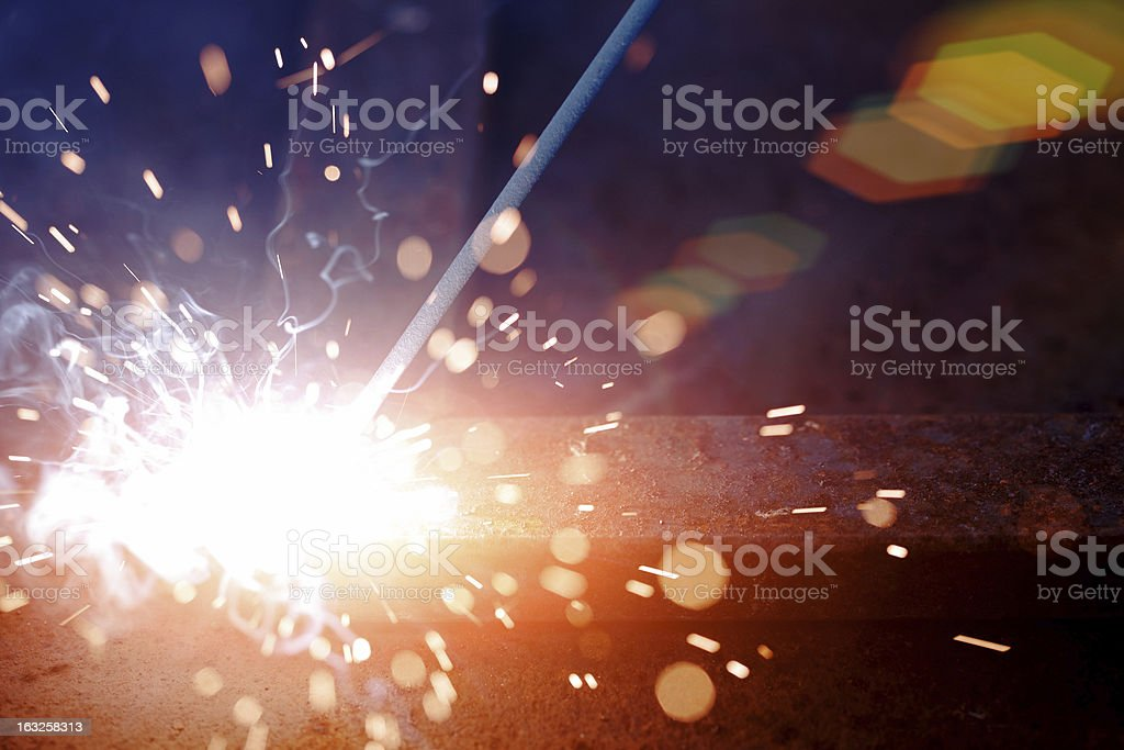 Bright sparks flying from a welding iron stock photo