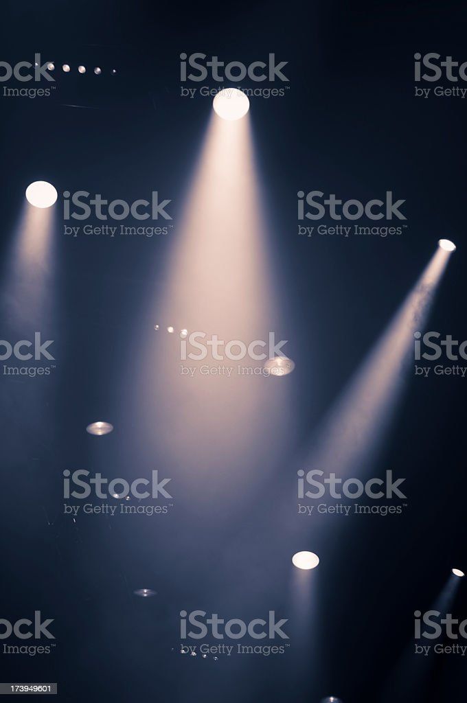 Bright stage lights shining down from the ceiling royalty-free stock photo