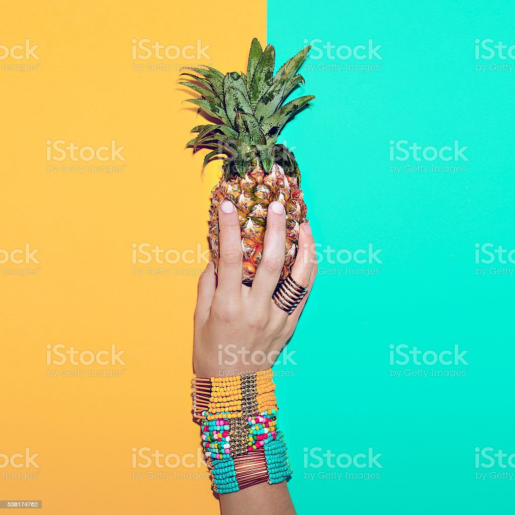 Bright stylish bracelets and Pineapple. Go to the beach. Tropica stock photo