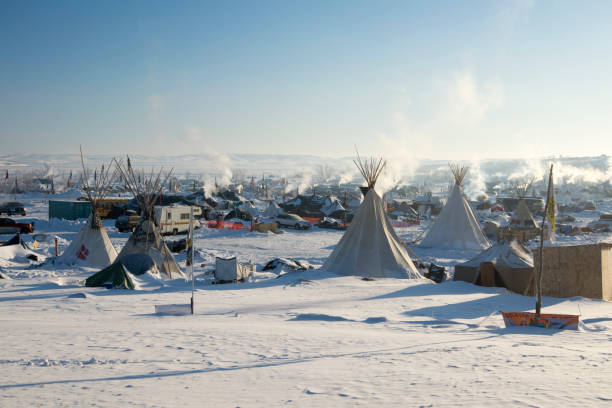 bright sun at oceti sakowin camp in the early morning - native american reservation stock photos and pictures