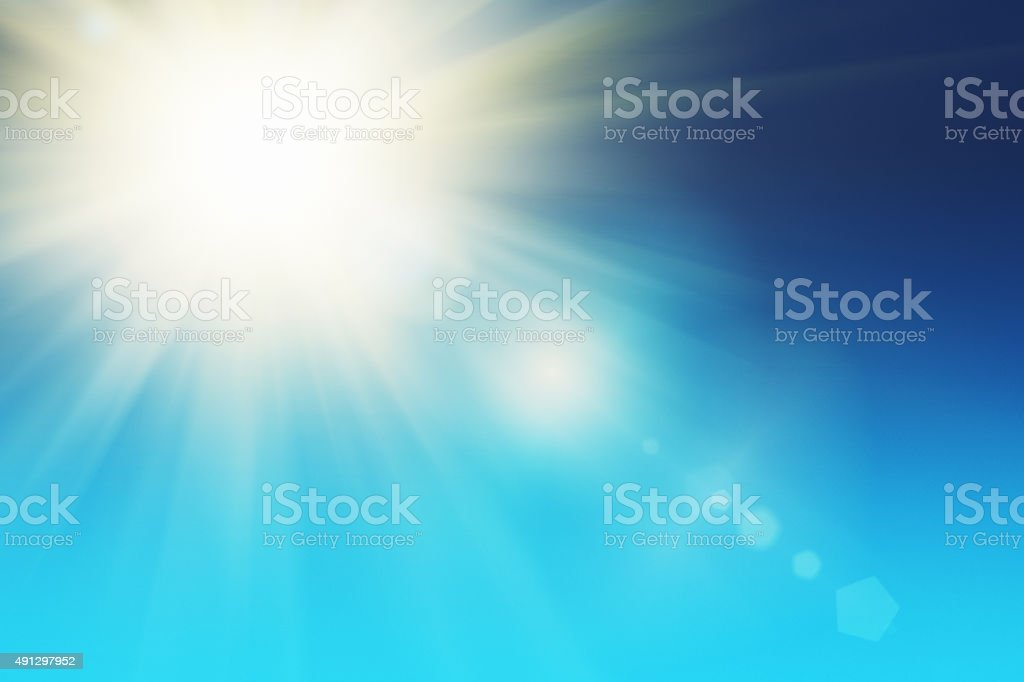 Bright sun in clear sky with copy space, stock photo