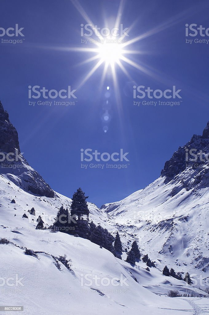 Bright sun in winter mountains royalty-free stock photo