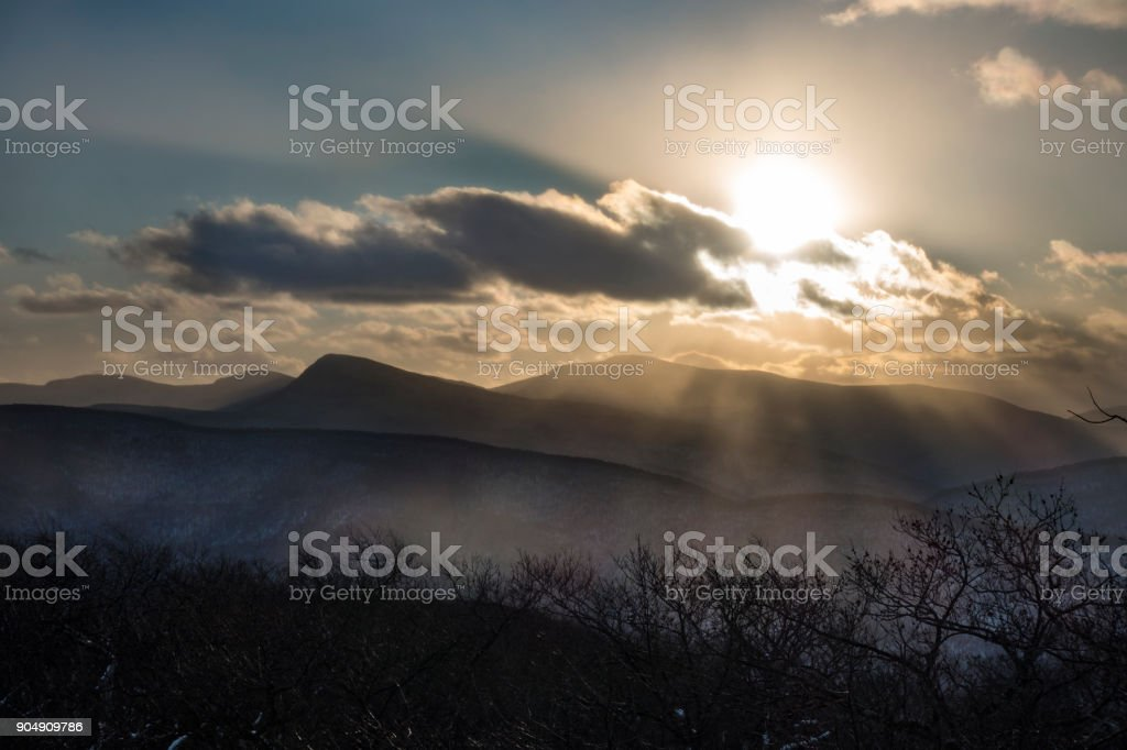 Bright Sun Piercing Clouds in the Catskill Mountains stock photo