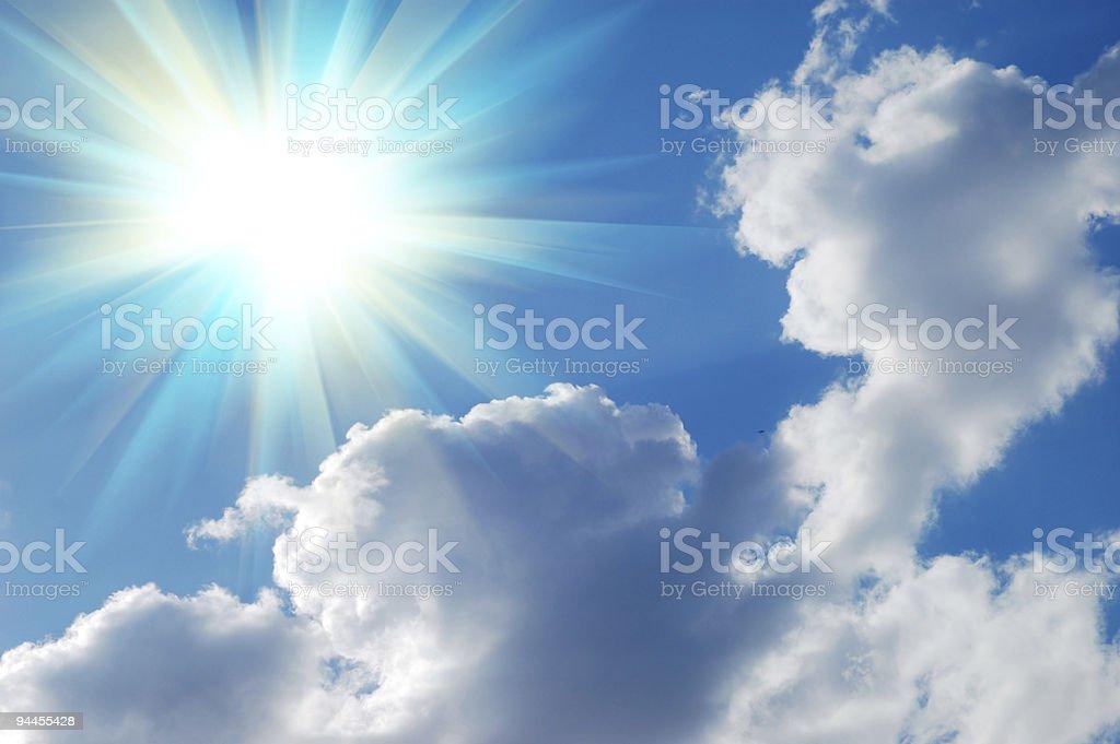 Bright sun shining on a blue sky royalty-free stock photo