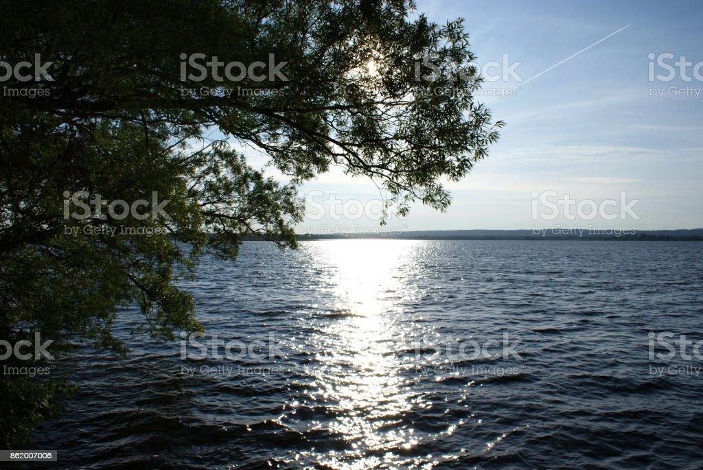 Bright Sun Shining Over The Lake stock photo