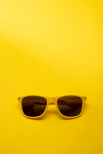Yellow Sunglasses on a yellow background