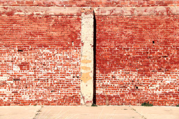bright sunlit vintage red brick building wall stock photo