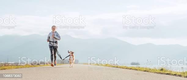 Bright sunny morning canicross exercises female runs with his beagle picture id1068373052?b=1&k=6&m=1068373052&s=612x612&h=svrxz9vboj0g ktsa2zyjfgniheqhvf5xxhmh ybegu=
