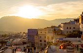 istock Bright sunset over Chefchaouen town, Morocco. The roofs of the medina of the Blue city in warm colors. Travel to North Africa 1280953561