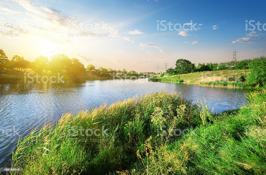 Bright sunset over river stock photo
