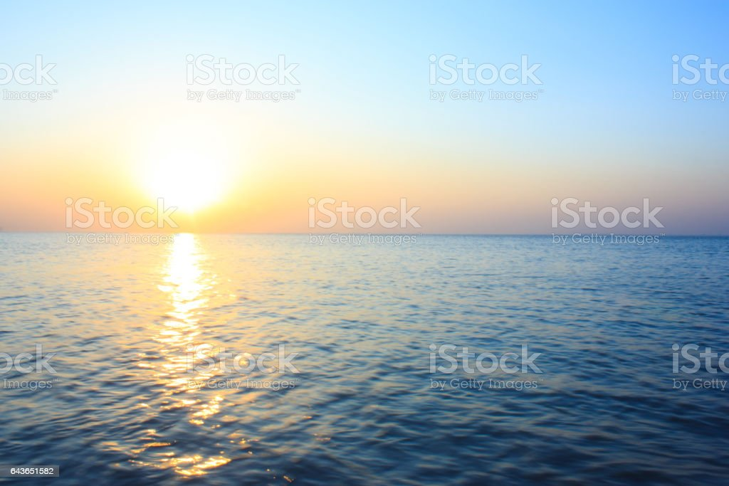 Bright sunset over water stock photo