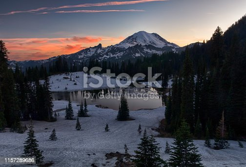 Colorful sunset over Mt. Rainier and Tipsoo lake snow covered landscape in the Mt.Rainier National park, Washington, USA