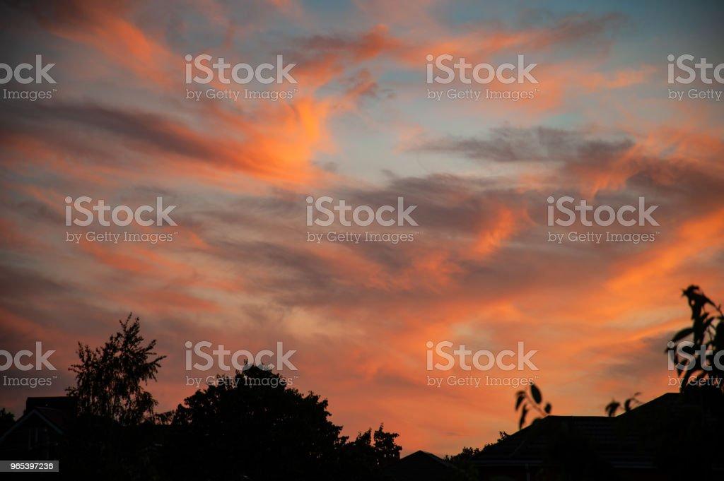 Bright sunset red sky with clouds zbiór zdjęć royalty-free