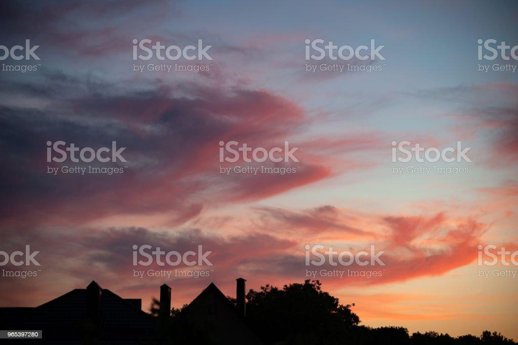 Bright sunset sky with clouds zbiór zdjęć royalty-free