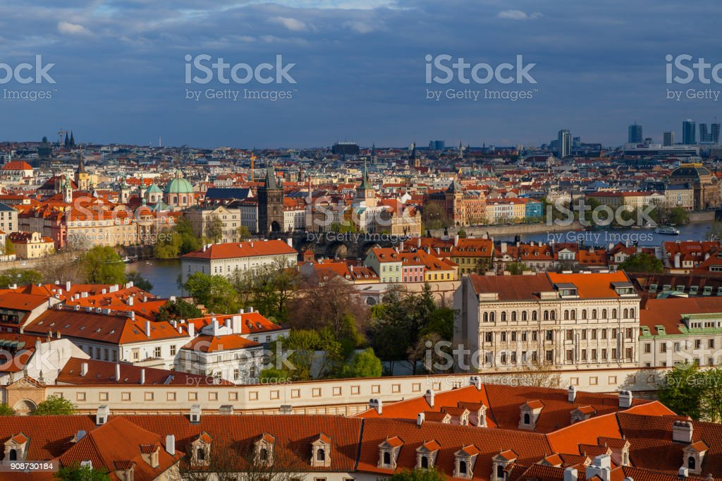 Bright sunset view of old town skyline with bridges and Vltava river from Hradcany castle. Skyline of Prague, Czech Republic stock photo