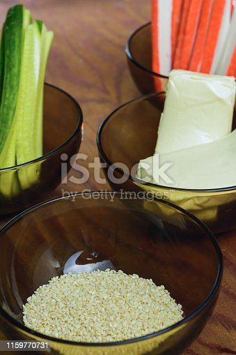 istock Bright tasty products in plates on the table as ingredients for the preparation of sushi shooting from the top viewpoint 1159770731