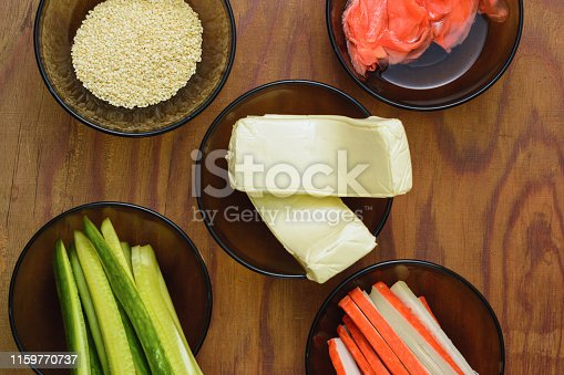 istock Bright tasty products in plates on the table as ingredients for the preparation of sushi shooting from the top viewpoint 1159770737