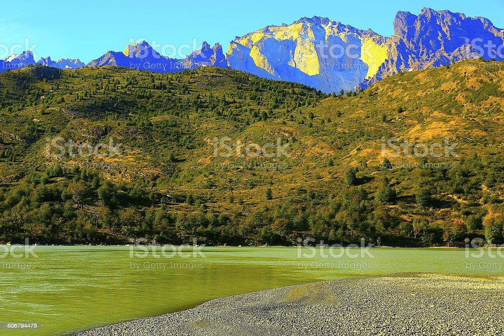 Bright Torres del Paine mountain range & Lake shore, Patagonia royalty-free stock photo