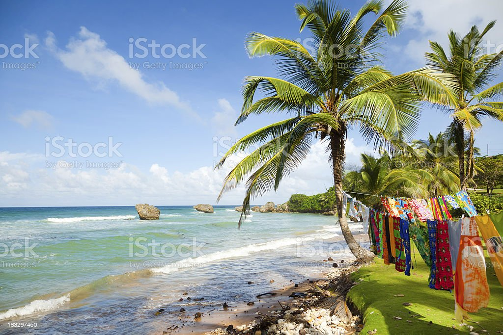 Bright tranquil beach in Barbados. Clothing drying in sun stock photo