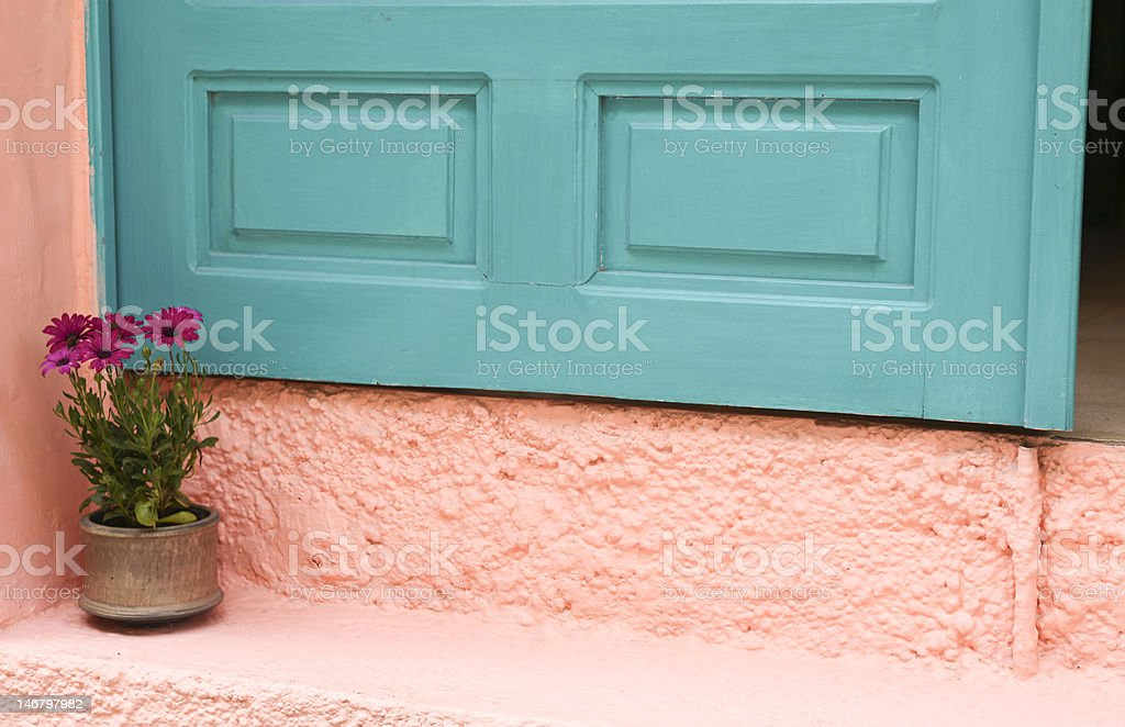 Bright turquoise green with pink wall in Greece royalty-free stock photo