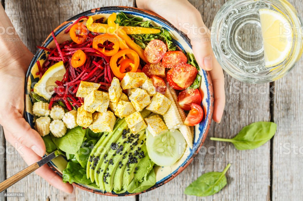 Bright vegetable buddha bowl with tofu. stock photo
