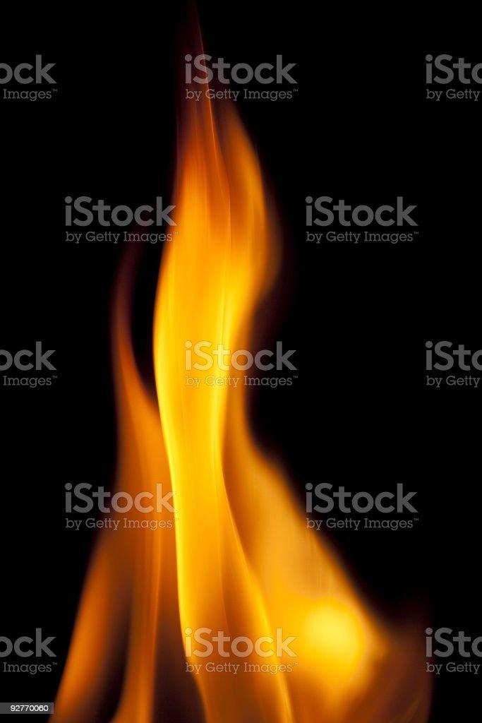 Helle vertikale Flammen auf schwarzem Hintergrund Lizenzfreies stock-foto