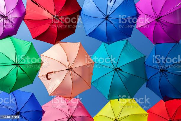 Bright vibrant colorful umbrellas parasols row pattern blue sky picture id644015884?b=1&k=6&m=644015884&s=612x612&h=daqlsp9gae2c keuwuk0wkqnpt 0c h8x0btmmgaloy=