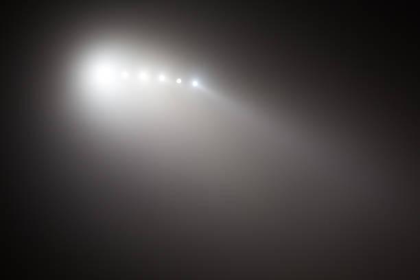 Bright white and yellow Stadium lights with fog. Defocused image