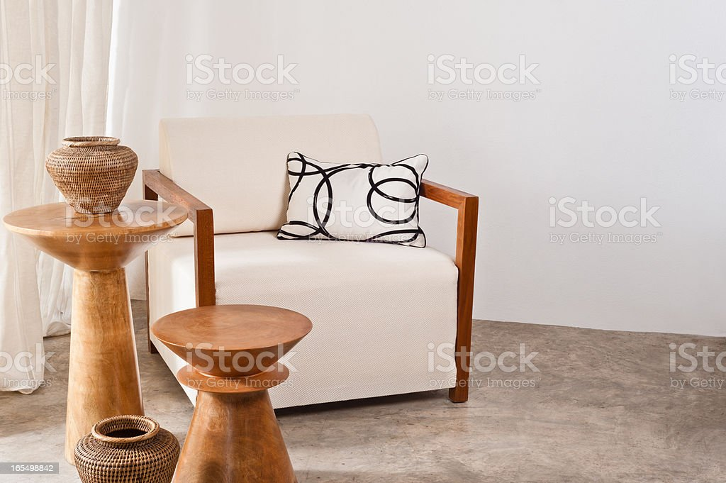 Bright white armchair in a living room royalty-free stock photo