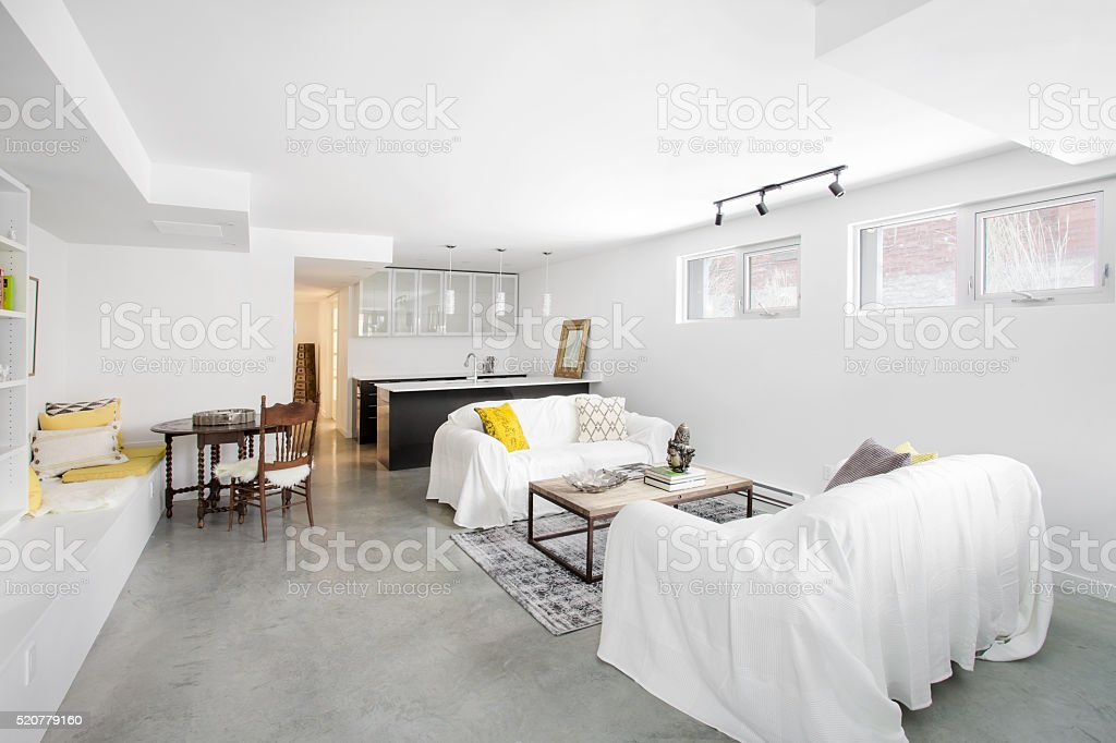 Bright white open plan living room and kitchen. stock photo