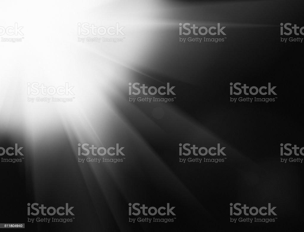 Bright white starburst on black stock photo