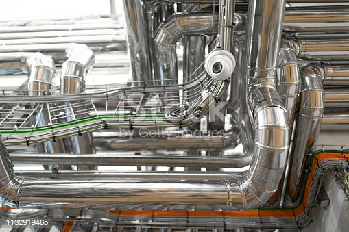 1132919452istockphoto bright wires and chrome pipes. industrial background 1132919465